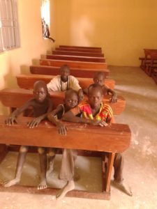 Children tested and tasted sitting in furnished classroom
